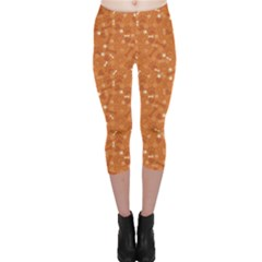 Orange Pattern With Dog Paw Print Bone And Hearts Orange Capri Leggings by CoolDesigns